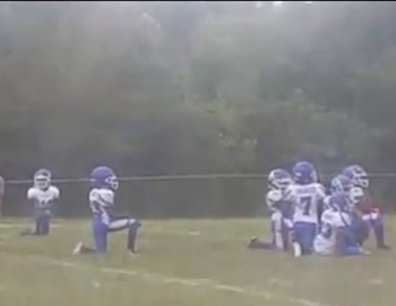 8-year-old football players kneel during anthem