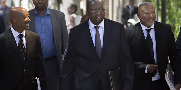 Previous finance minister Nhlanhla Nene (C) with Commissioner of the South African Revenue Service Tom Moyane (L) and former deputy finance minister Mcebisi Jonas.