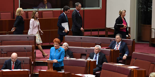 Green Party senators walk out as Australia's One Nation party  leader Senator Pauline Hanson (C) makes her maiden speech in the Senate at Parliament House in Canberra, Australia, September 14, 2016.
