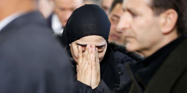 Une femme en deuil lors de la cérémonie d'hommage aux trois victimes de l'attentat du centre culturel islamique de Montreal, le 2 février 2017. REUTERS/Chris Wattie