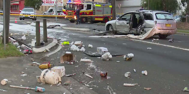 Woman's body left on footpath after Sydney auto crash
