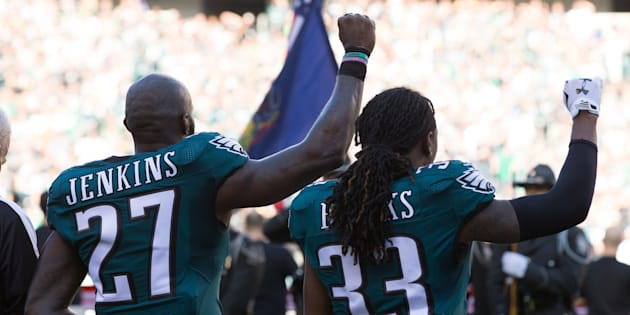 Philadelphia Eagles strong safety Malcolm Jenkins and defensive back Ron Brooks hold up fists during the national anthem before a game against the Pittsburgh Steelers at Lincoln Financial Field.