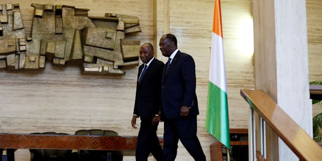 Ivory Coast President Alassane Ouattara (R) walks with the new Prime Minister Amadou Gon Coulibaly in the Presidential Palace in Abidjan, Ivory Coast January 10, 2017.