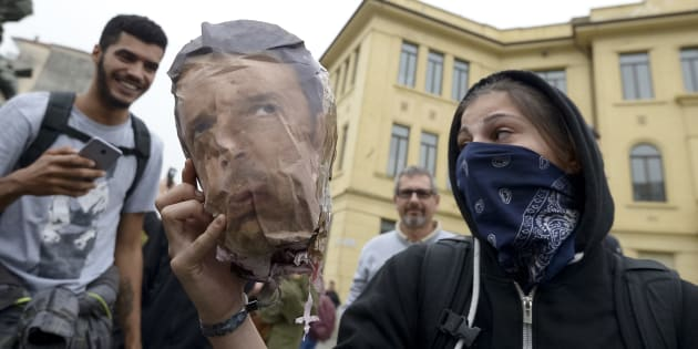VENARIA, TURIN, ITALY - 2017/09/30: A demonstrator shows the head of a dummy with the face of Matteo Renzi after his decapitation during the demonstration against the G7 meeting in Turin.