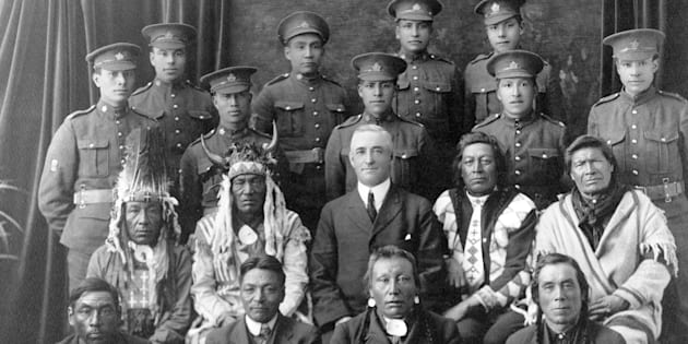 Recruits from File Hills, Sask. pose with elders and a government representative in a 1915 photo from the Saskatchewan Provincial Archives Collection.