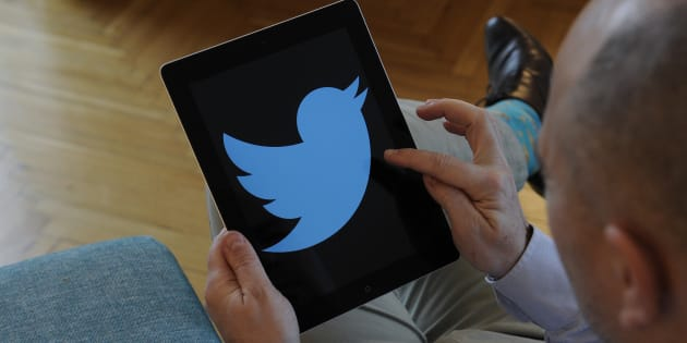 A man is seen holding an iPad with a Twitter logo on it's screen on November 10, 2017. (Photo by Jaap Arriens/NurPhoto via Getty Images)