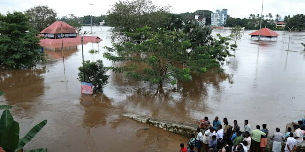 Indian residents look at the Shiva Temple submerged after the release of water from Idamalayar dam following heavy rains in Kochi on August 9, 2018.