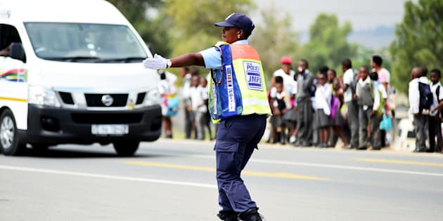 Johannesburg Metro Police Department (JMDP) officer Dorah Mofokeng directs traffic at the corner of Witkoppen and Cedar roads on March 14, 2017 in Fourways, Johannesburg, South Africa. Mofokeng, who started working for JMPD seven years ago, says she entertains motorists because they complain a lot.