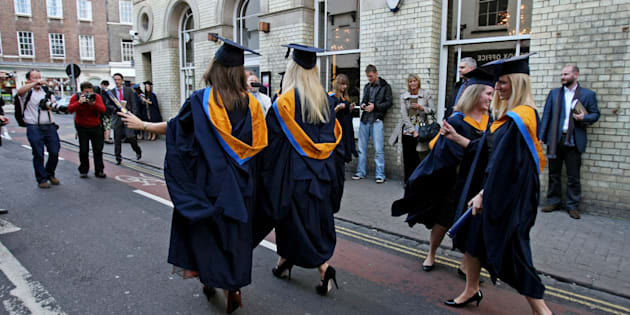 A general view of students wearing Mortar Boards and Gowns after graduating from Anglia Ruskin University in Cambridge.