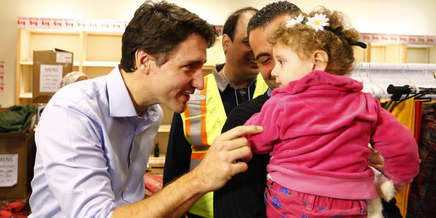 Syrian refugees are greeted by Prime Minister Justin Trudeau on their arrival from Beirut at the Toronto Pearson International Airport on Dec. 11, 2015.