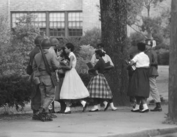 Photos show troops guard 9 black children in 1957