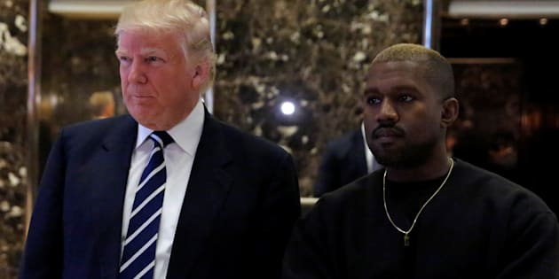 U.S. President-elect Donald Trump and musician Kanye West pose for media at Trump Tower in Manhattan, New York City, U.S., December 13, 2016.  REUTERS/Andrew Kelly