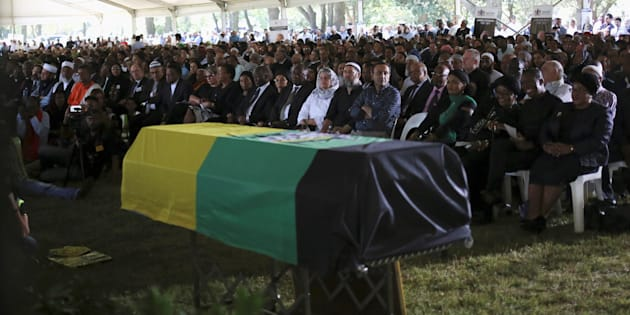 Mourners attend a funeral of Ahmed Kathrada, who was sentenced to life imprisonment alongside Nelson Mandela, at the Westpark Cemetery in Johannesburg, South Africa March 29, 2017.