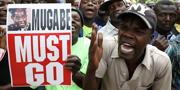 Protesters call for Zimbabwean President Robert Mugabe to resign.