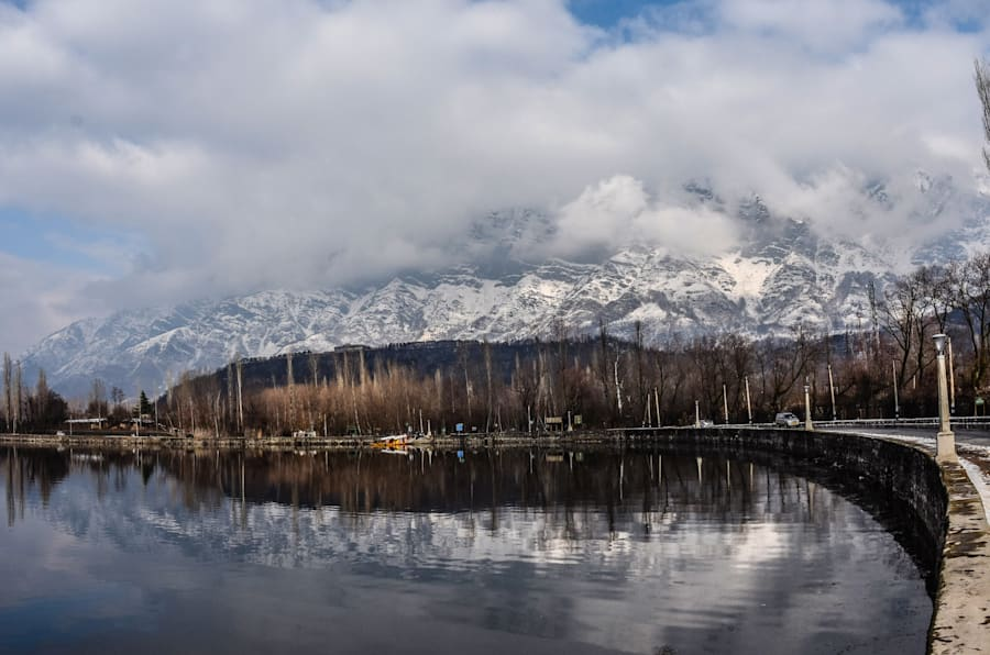 Shikara boats are moored the bank of Dal lake next to the snow clad  mountains in Dal Lake on February 06, 2017 in Srinagar, the summer capital of Indian Administered Kashmir, India. Cold weather continued in the Kashmir valley with most places in the state recording sub-zero temperatures.(Photo by Yawar Nazir/Getty Images)