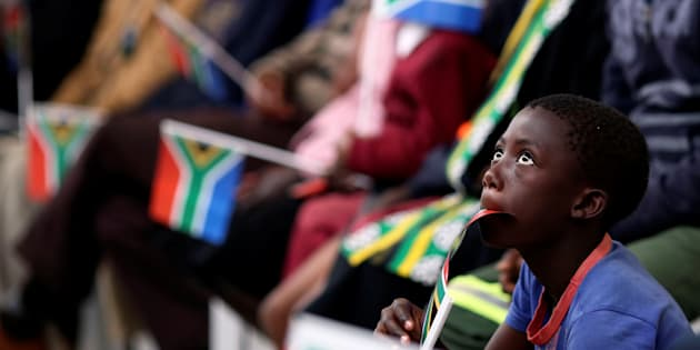 A boy holds a flag as President Jacob Zuma addresses the National Youth Day Commemoration in Ventersdorp, South Africa, on June 16 2017.