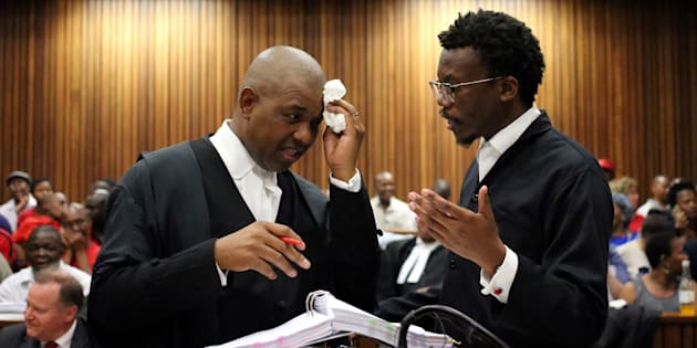 Advocate Dali Mpofu (L) chats to advocate Tembeka Ngcukaitobi during argument in court on a report into allegations of political interference by wealthy friends of President Jacob Zuma, at the North Gauteng High Court, in Pretoria, South Africa, November 2, 2016.