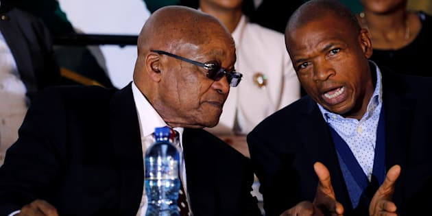 Jacob Zuma chats with North West premier Supra Mahumapelo.