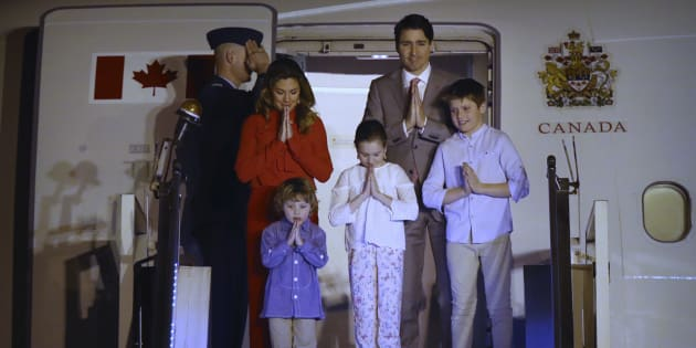 """Prime Minister Justin Trudeau, his wife, Sophie Gregoire Trudeau, their sons Hadrien and Xavier, and daughter Ella-Grace, greet with a traditional Indian """"namaste"""" as they step out of the aircraft upon their arrival at the Palam Air Force Station in New Delhi, India on Saturday."""