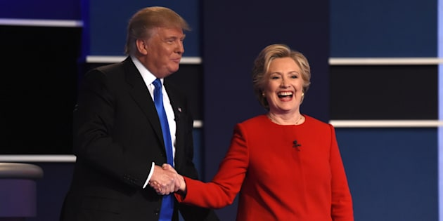 Democratic nominee Hillary Clinton (R) shakes hands with Republican nominee Donald Trump after the first presidential debate at Hofstra University in Hempstead, New York on September 26, 2016. / AFP / Timothy A. CLARY        (Photo credit should read TIMOTHY A. CLARY/AFP/Getty Images)