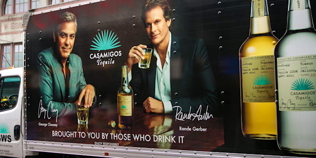SEATTLE, WA - NOVEMBER 5: The side of a delivery truck features a billboard promoting George Clooney and Rande Gerber's new Casamigos Tequila on November 5, 2015, in Seattle, Washington. Seattle, located in King County, is the largest city in the Pacific Northwest, and is experiencing an economic boom as a result of its European and Asian global business connections. (Photo by George Rose/Getty Images)