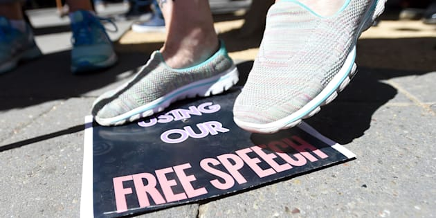 A woman stomps on a free speech sign after commentator Milo Yiannopoulos spoke to a crowd of supporters on the University of California, Berkeley campus on Sep. 24, 2017.