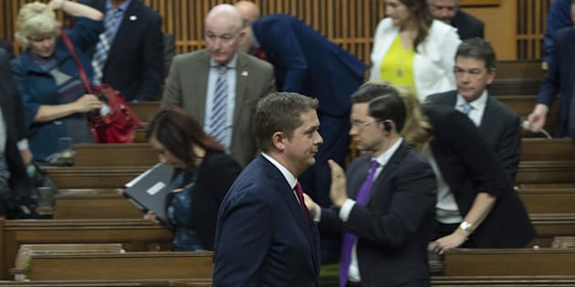 Conservative leader Andrew Scheer leads members of his party out of the House of Commons during the delivery of the federal budget in the House of Commons on March 19, 2019 in Ottawa.