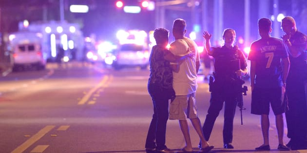 Orlando Police direct family members away from a multiple shooting at a nightclub in Orlando, Florida.