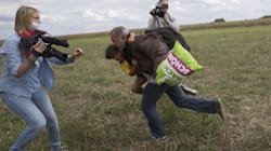 Hungarian TV Camerawoman Who Kicked And Tripped Refugees Is Acquitted By