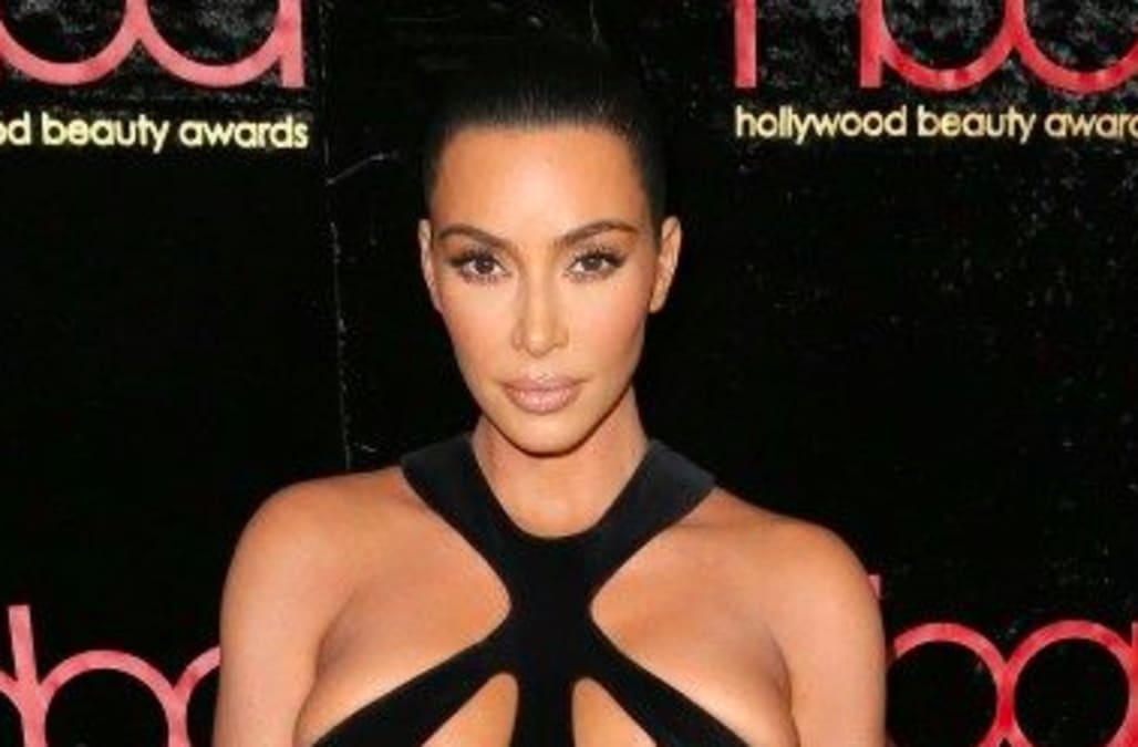 f1f401f70e7 Kim Kardashian rocks her most revealing look yet  See the sexy vintage gown!