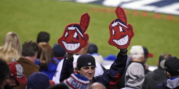 A fan holds up two Chief Wahoo heads during Game 1 of the 2016 World Series between Chicago and Cleveland at Progressive Field on Oct. 25, 2016 in Cleveland, Ohio.