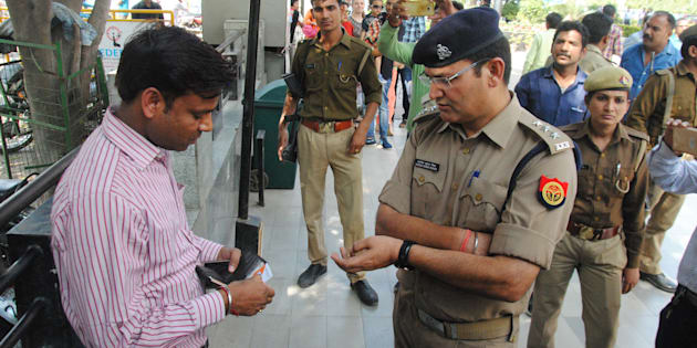 Lucknow Police run an anti-Romeo operation at Saharaganj mall, on March 22, 2017 in Lucknow, India.