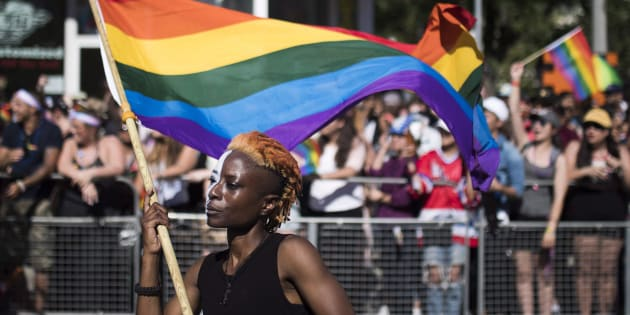 A woman holds a flag during the Pride parade in Toronto on June 25, 2017.