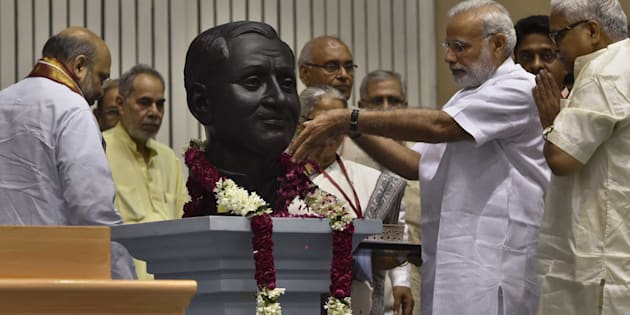 NEW DELHI, INDIA - OCTOBER 9: Prime Minister Narendra Modi along with others pay tribute to Pandit Deendayal Upadhayaya on his birth Anniversary at Vigyan Bhawan, on October 9, 2016 in New Delhi, India.