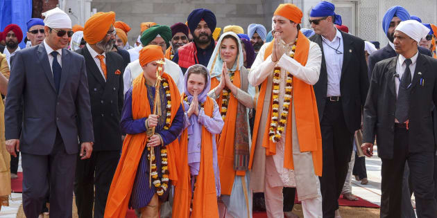 Prime Minister Justin Trudeau walks with his family members during their visit to Golden Temple, in Amritsar, India on Wednesday.