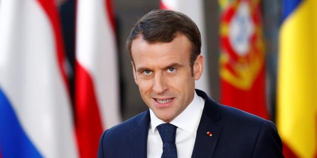 Emmanuel Macron, jeudi, à son arrivée à Bruxelles pour un conseil européen qui doit faire un pas décisif vers un budget de la zone euro.