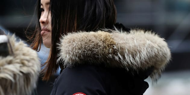 A woman wears a Canada Goose jacket in Times Square, New York, March 16, 2017. Canada Goose shares have tanked in recent days, amid talk of a boycott in China brought about by the arrest of Huawei's chief financial officer in Vancouver.
