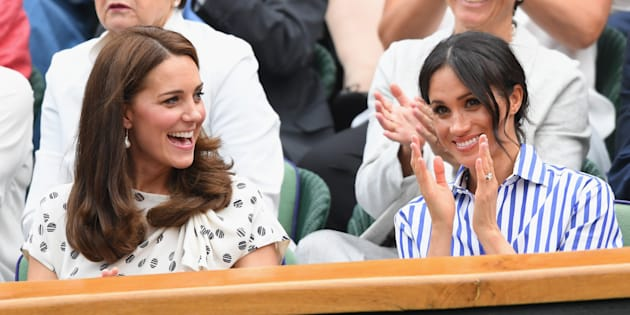 Catherine, Duchess of Cambridge, and Meghan, Duchess of Sussex, attend day twelve of the Wimbledon Tennis Championships at the All England Lawn Tennis and Croquet Club on Saturday in London.
