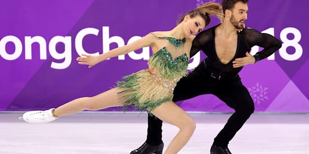 French Olympic ice dancer endures wardrobe malfunction to stay in medal contention