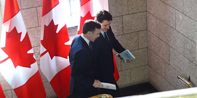 Finance Minister Bill Morneau, left, and Prime Minister Justin Trudeau leave the prime minister's office to table the federal budget in the House of Commons in Ottawa on Feb. 27, 2018.