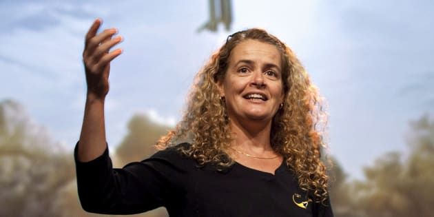 Canadian astronaut Julie Payette describes her mission to the International Space Station with a photograph in the background of the space shuttle on Aug. 28, 2009 in Longueuil, Que.