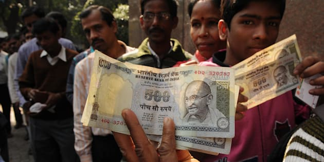 People in queue waiting outside bank with old 500 Rs. notes in front of RBI.