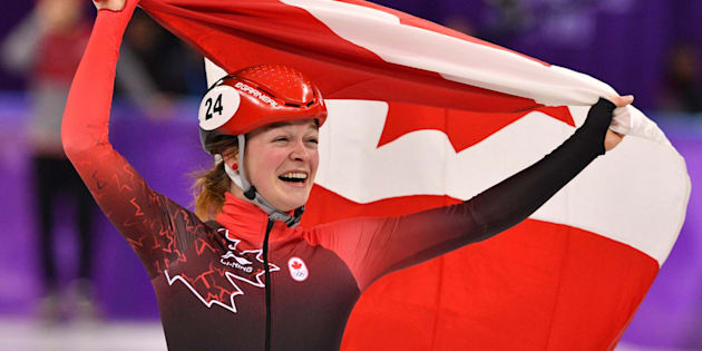 Canada's Kim Boutin celebrates her bronze in the women's 1,500-metre short-track speedskating event.
