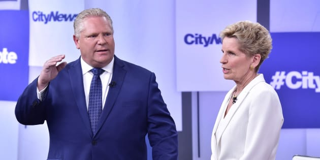 Liberal Premier Kathleen Wynne, right, and Progressive Conservative Leader Doug Ford take part in an Ontario Leaders debate in Toronto on May 7, 2018.