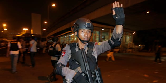 Police guard at a scene of an explosion in Jakarta on Wednesday night.