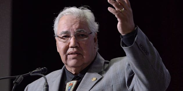 Commission chairman Justice Murray Sinclair raises his arm asking residential school survivors to stand at the Truth and Reconciliation Commission in Ottawa on June 2, 2015.