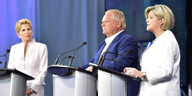 Ontario NDP Leader Andrea Horwath speaks as Ontario Liberal Leader Kathleen Wynne, and Ontario Progressive Conservative Leader Doug Ford look on during the final televised debate of the provincial election campaign in Toronto on Sunday.