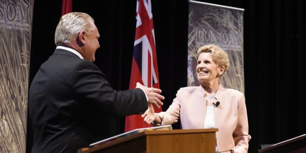 Ontario Progressive Conservative Leader Doug Ford, left, and Ontario Liberal Leader Kathleen Wynne shake hands after taking part in the second of three leaders' debate in Parry Sound, Ont. on May 11, 2018.