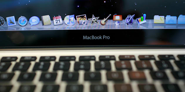 The keyboard and applications on an Apple MacBook Pro are shown at the Apple retail store in San Francisco, California, U.S. July 21, 2009.  REUTERS/Robert Galbraith/File Photo