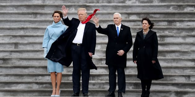 U.S. First Lady Melania Trump, from left, U.S. President Donald Trump, Vice President Mike Pence, and Second Lady Karen Pence wave on the West Front of the U.S. Capitol after the 58th presidential inauguration in Washington, D.C., U.S., on Friday, Jan. 20, 2017. Trump became the 45th president of the United States today, in a celebration of American unity for a country that is anything but unified Photographer: Rob Carr/Pool via Bloomberg